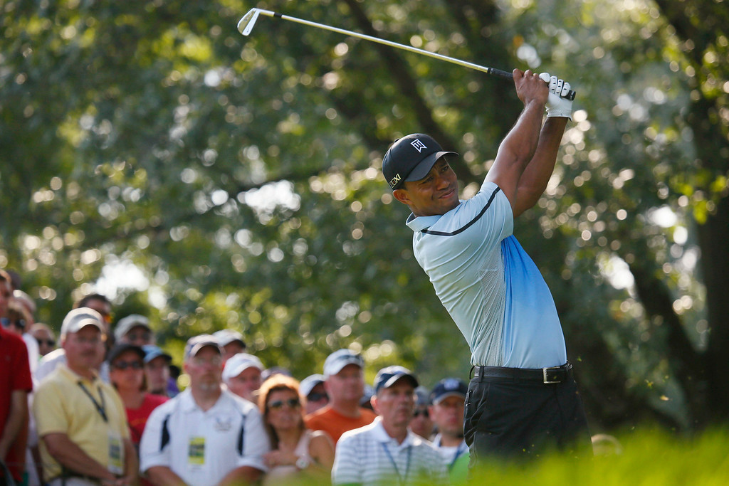 . Tiger Woods tees off on 13 during the first round of the PGA Championship golf tournament at Oak Hill Country Club, Thursday, Aug. 8, 2013, in Pittsford, N.Y. (AP Photo/The Buffalo News, Derek Gee)