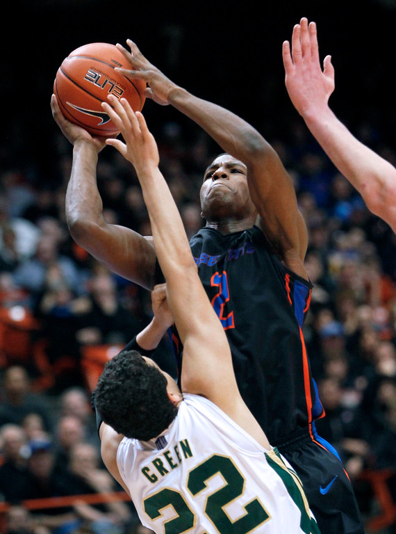 . Boise State guard Derrick Marks (2) scores AGAINST Colorado State Dorian Green (22) during an NCAA college basketball game in Boise, Idaho, Saturday, March 2, 2013.  (AP Photo/Darin Oswald)