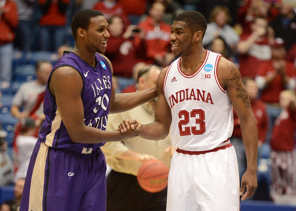 . DAYTON, OH - MARCH 22: Arman Marks #30 of the James Madison Dukes and Remy Abell #23 of the Indiana Hoosiers shake hands at the end of the game during the second round of the 2013 NCAA Men\'s Basketball Tournament at UD Arena on March 22, 2013 in Dayton, Ohio.  (Photo by Jason Miller/Getty Images)
