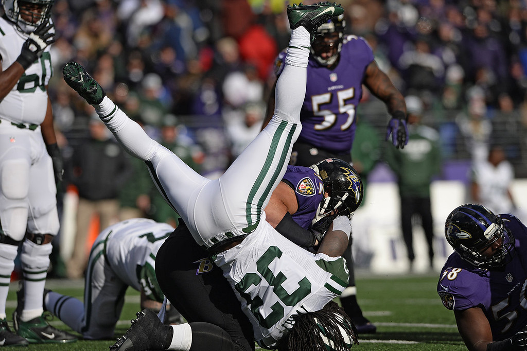 . Running back Chris Ivory #33 of the New York Jets is tackled by nose tackle Haloti Ngata #92 of the Baltimore Ravens in the first quarter at M&T Bank Stadium on November 24, 2013 in Baltimore, Maryland. (Photo by Patrick Smith/Getty Images)