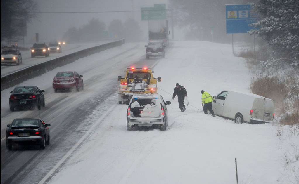 . A van is pulled from a ditch along Interstate 94 near U.S. Route 127 in Jackson, Mich., on Thursday, Jan. 2, 2014. (AP Photo/The Jackson Citizen Patriot, J. Scott Park)