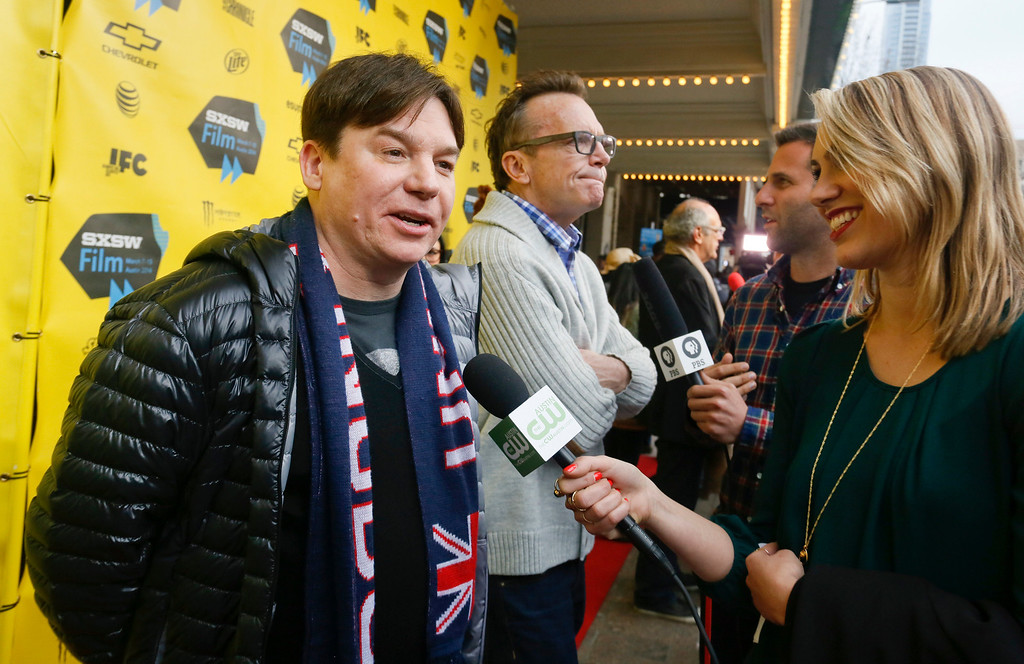 ". Mike Myers, left, and Tom Arnold, center, arrive on the red carpet for a screening of their new film ""Supermensch\"" during the SXSW Film Festival on Sunday, March 9, 2014 in Austin, Texas. (Photo by Jack Plunkett/Invision/AP)"
