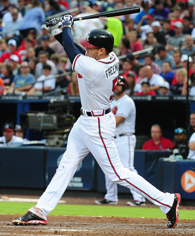 . Freddie Freeman #5 of the Atlanta Braves hits a run-scoring single in the third inning against the Colorado Rockies at Turner Field on July 31, 2013 in Atlanta, Georgia. (Photo by Scott Cunningham/Getty Images)