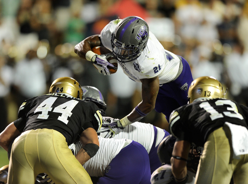 . BOULDER, CO. - SEPTEMBER 76: ACU running back Willie Mathews (21) was stopped short on a third down attempt over the middle. The University of Colorado football team hosted Central Arkansas at Folsom Field Saturday night, September 7, 2013. Photo By Karl Gehring/The Denver Post