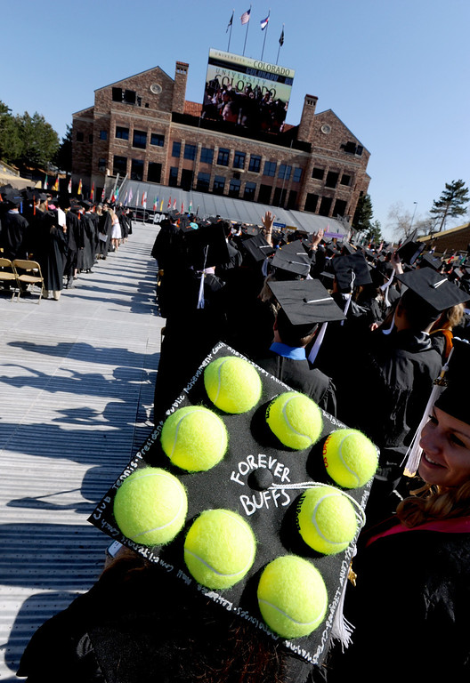 . Brianna Laffey had a lot of tennis balls attached to her cap  during the 2013 University of Colorado Spring Commencement on Friday in Boulder, Colorado, May 10, 2013. (AP Photo/The Daily Camera, Cliff Grassmick)