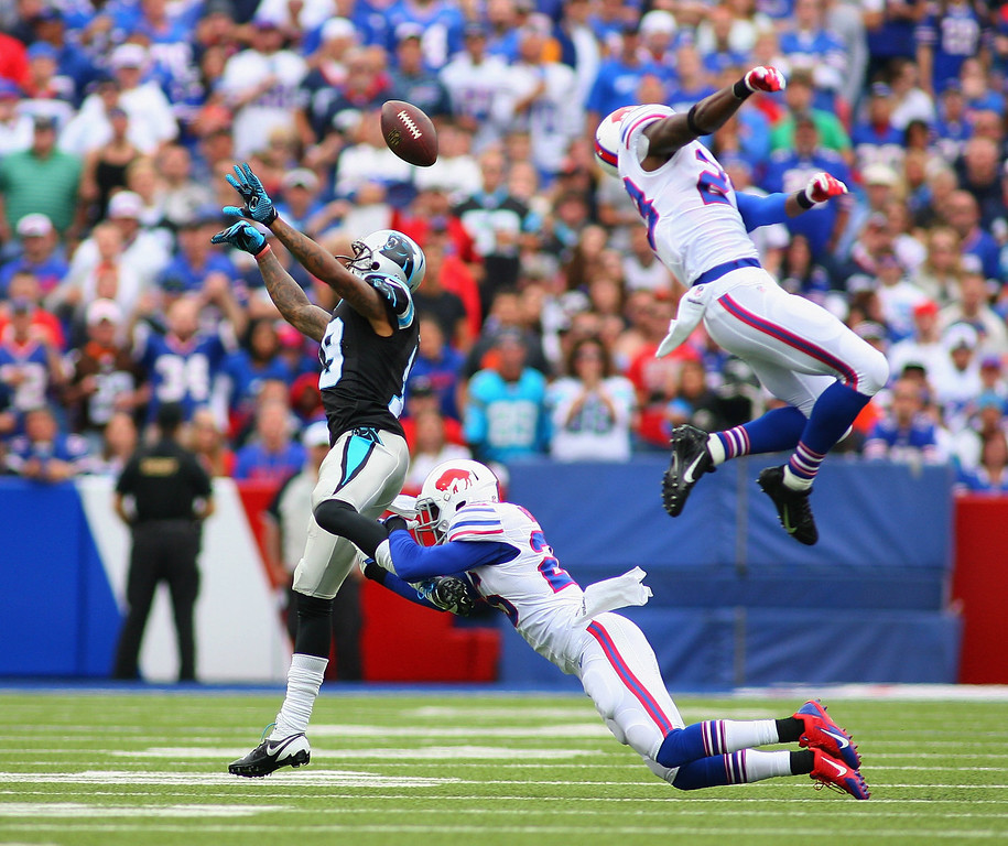 . Justin Rogers #26  (bottom)and  Aaron Williams #23 of the Buffalo Bills break up a pass intended for  Ted Ginn #19 of the Carolina Panthers at Ralph Wilson Stadium on September 15, 2013 in Orchard Park, New York.  (Photo by Rick Stewart/Getty Images)