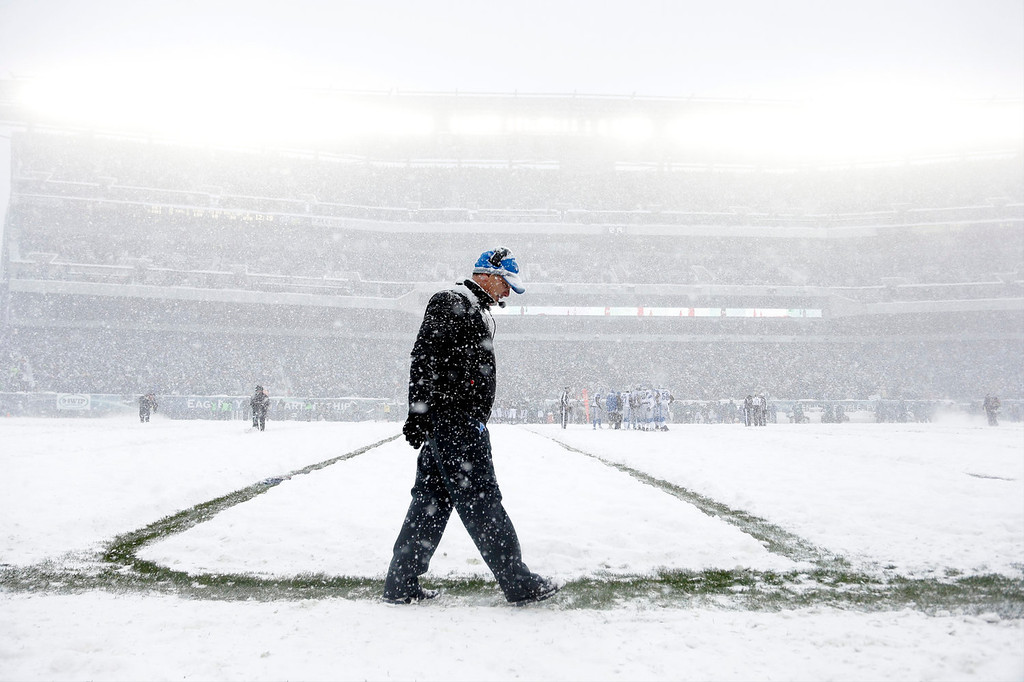 . Detroit Lions head coach Jim Schwartz walks the sidelines as snow falls during the first half of an NFL football game against the Philadelphia Eagles, Sunday, Dec. 8, 2013, in Philadelphia. (AP Photo/Matt Rourke)