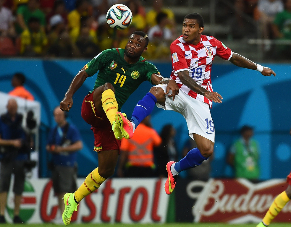 . Cameroon\'s defender Aurelien Chedjou (L) challenges Croatia\'s midfielder Sammir (R) for the ball during the Group A football match between Cameroon and Croatia at The Amazonia Arena in Manaus on June 18, 2014, during the 2014 FIFA World Cup.  RAPHAEL ALVES/AFP/Getty Images