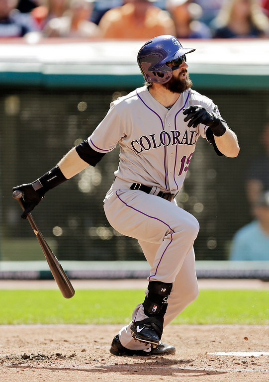 . Colorado Rockies\' Charlie Blackmon singles to drive in a run in the third inning of a baseball game against the Cleveland Indians Saturday, May 31, 2014, in Cleveland. (AP Photo/Mark Duncan)