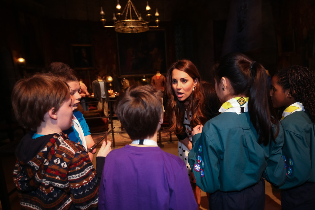 . Catherine, Duchess of Cambridge speaks with children during the Inauguration Of Warner Bros. Studios Leavesden on April 26, 2013 in London, England.  (Photo by Paul Rogers - WPA Pool/Getty Images)