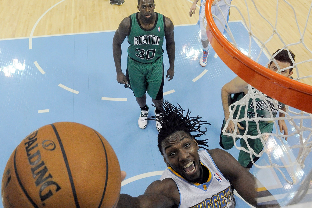 . Denver Nuggets power forward Kenneth Faried (35) goes up for an easy basket against the Boston Celtics during the second quarter January 7, 2014 at Pepsi Center. (Photo by John Leyba/The Denver Post)