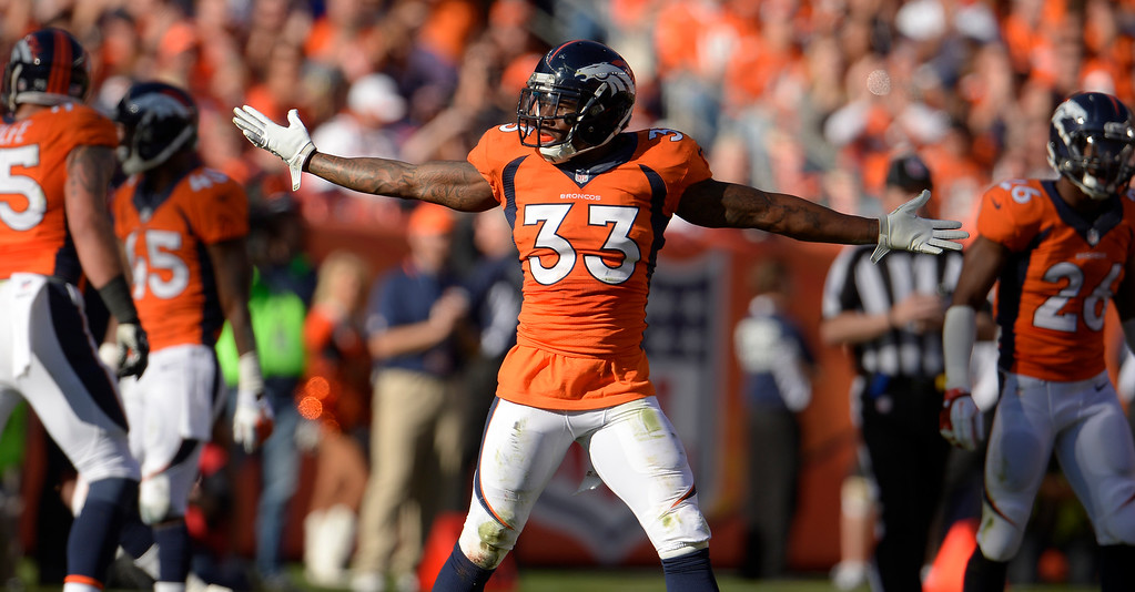 . Denver Broncos strong safety Duke Ihenacho (33) celebrates a play in the second quarter against the Washington Redskins.  (Photo by Joe Amon/The Denver Post)