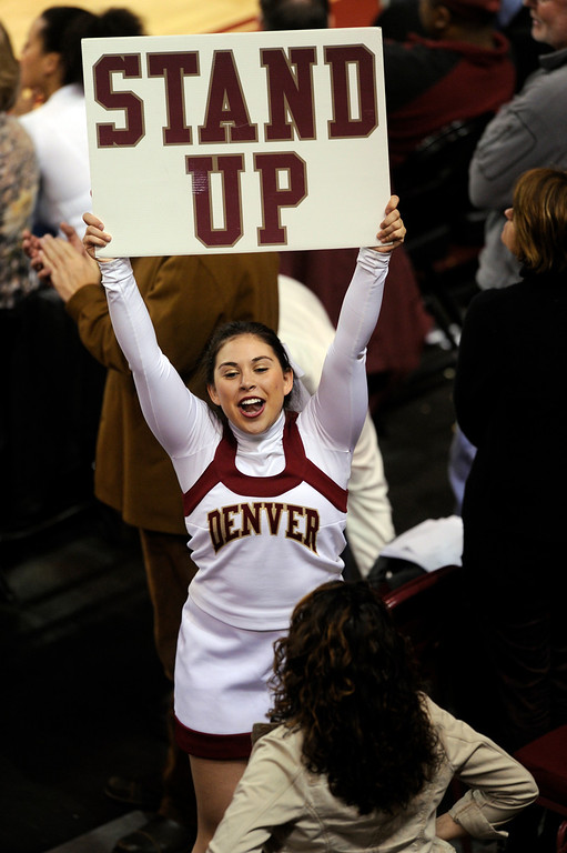 . DENVER, CO. - MARCH 2: Cheerleaders had fans on their feet in the second half. The University of Denver men\'s basketball team defeated New Mexico State 66-60 Saturday evening, March 2, 2013 at Magness Arena. (Photo By Karl Gehring/The Denver Post)