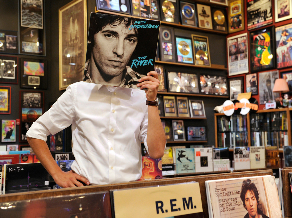 . Denver\'s Public Art Program Manager Michael Chavez picked Twist & Shout record store as his favorite place. He looked through vinyl Thursday afternoon, July 26, 2012. He posed with The River album by Bruce Springsteen which was released in 1980. Karl Gehring/The Denver Post