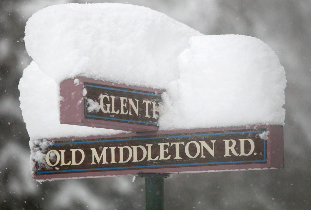 . The street sign at Old Middleton and Glen Hollow Roads is topped with several inches of snow in Madison, Wis., Thursday afternoon, Dec. 20, 2012. (AP Photo/Wisconsin State Journal, M.P. King)