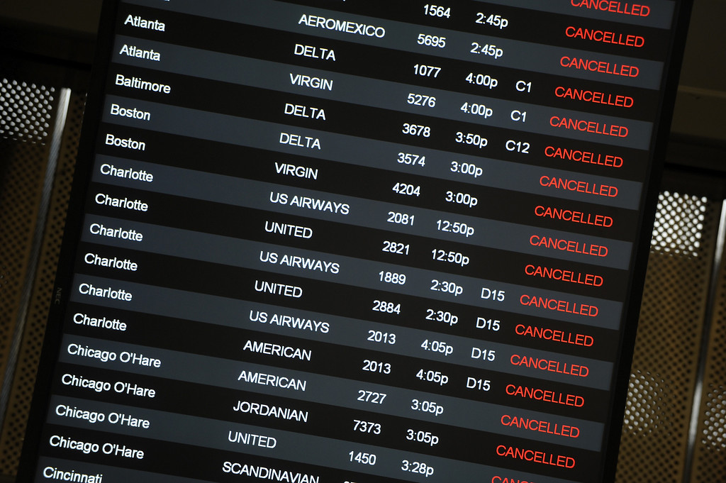 . Cancelled flights are shown at the Raleigh-Durham International Airport on February 12, 2014 in Morrisville, North Carolina. Over 100 flights were canceled by 2pm bacause of the winter storm hitting the area.  (Photo by Sara D. Davis/Getty Images)