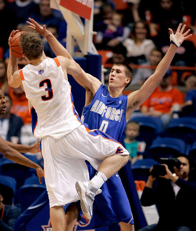 . Boise State\'s Anthony Drmic (3) shoots over Air Force\'s Marek Olesinski (0) during the second half of an NCAA college basketball game, Wednesday, Feb. 20, 2013, in Boise, Idaho. Boise State won 77-65. (AP Photo/Matt Cilley)