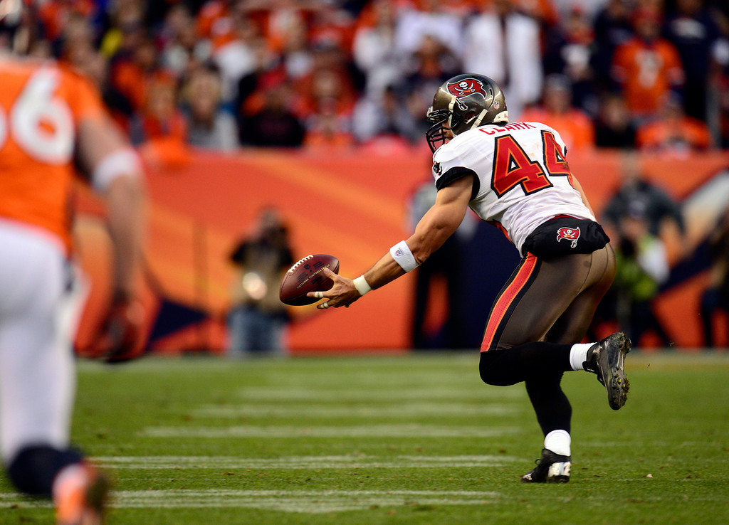 . Tampa Bay Buccaneers tight end Dallas Clark #44 tries to hold onto the ball but can\'t during the third quarter.  The Denver Broncos vs The Tampa Bay Buccaneers at Sports Authority Field Sunday December 2, 2012. Joe Amon, The Denver Post