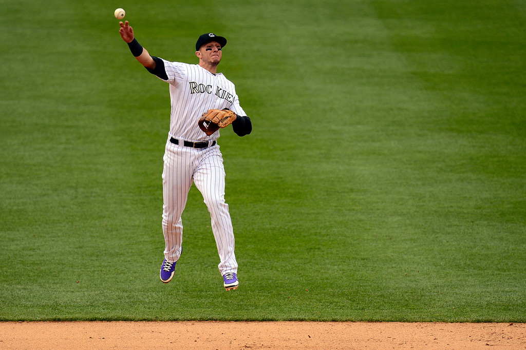 . DENVER, CO - MAY 5: Troy Tulowitzki (2) of the Colorado Rockies makes an acrobatic throw to get Evan Longoria (3) of the Tampa Bay Rays out during the Rockies\' 8-3 loss.   (Photo by AAron Ontiveroz/The Denver Post)