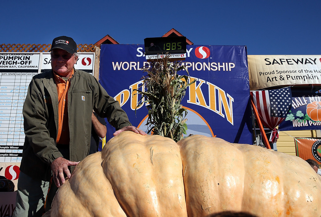 . Gary Miller of Napa, California stands with his giant pumpkin after winning the 40th Annual Safeway World Championship Pumpkin Weigh-Off on October 14, 2013 in Half Moon Bay, California. (Photo by Justin Sullivan/Getty Images)