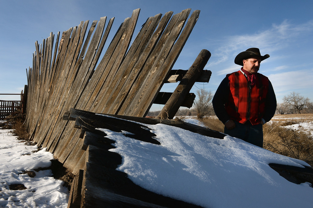 . KERSEY, CO - JANUARY 8, 2014: Rancher Jon Flack looks at a flood damaged corral on his ranch in Kersey, Co on January 8, 2014.  He is one of many ranchers that hasn\'t gotten much help from the government in helping to pay for expenses on his ranch incurred from the September floods. His losses included about  200 bales of hay worth about $30,000 which were destroyed when they were fully submerged in water.   As well many fences, fencing, corrals, ditches and land were severely damaged from the floods and need to be repaired.  Also, because much of his pasture land was completely submerged, he had to rent pasture land on which to keep his cattle.   (Photo By Helen H. Richardson/ The Denver Post)