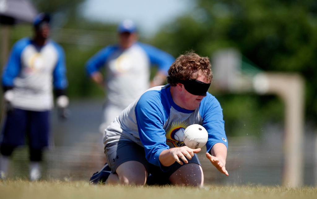 . Sam Hogle listens to the beep of the ball as he fields a hit by a player during a blind baseball game in Albany, Ga. on May 5, 2012.  (AP Photo/David Goldman)