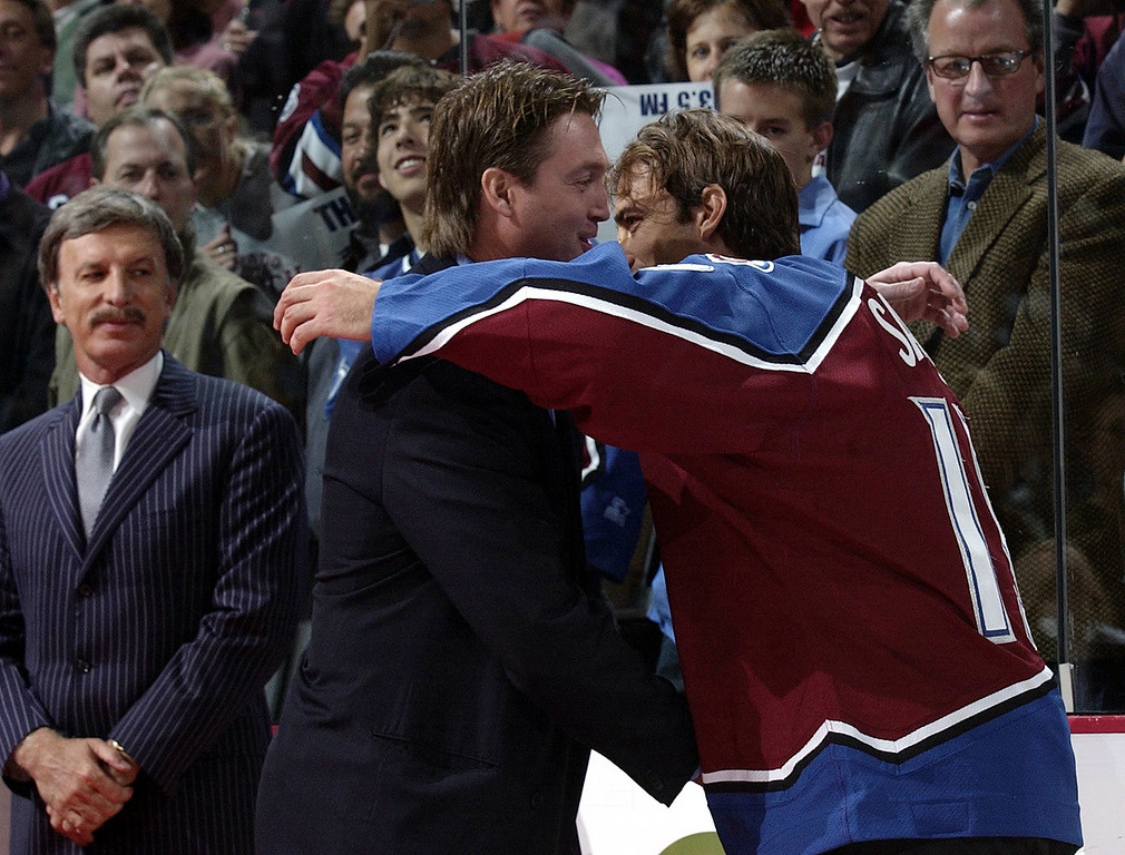 . Colorado Avalanche Joe Sakic gives Patrick Roy a hug after ceremonies at Pepsi Center as the Colorado Avalanche retired his jersey in 2003. (John Leyba/The Denver Post)