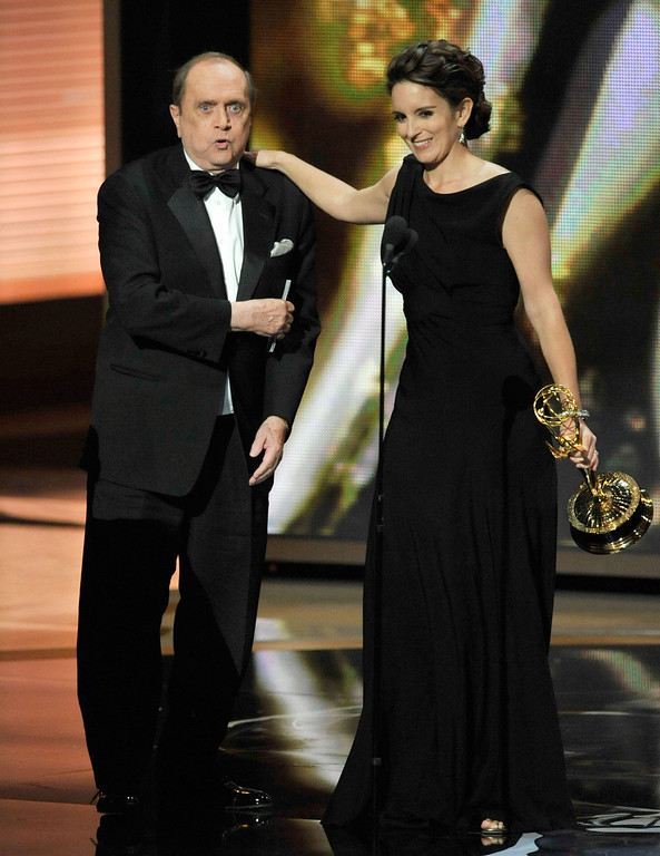". Actor Bob Newhart presents the Outstanding Comedy Series award to actress Tina Fey for ""30 Rock\"" onstage during the 61st Primetime Emmy Awards held at the Nokia Theatre on September 20, 2009 in Los Angeles, California.  (Photo by Kevin Winter/Getty Images)"