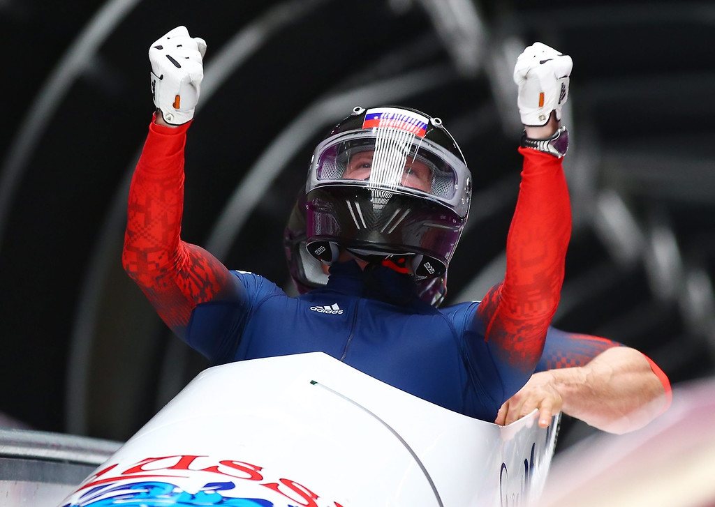 . Alexander Zubkov (front) and Alexey Voevoda of Russia react after the second run of the Two-Man Bobsleigh competition at the Sanki Sliding Center at the Sochi 2014 Olympic Games, Krasnaya Polyana, Russia, on Feb. 16, 2014. EPA/JENS BUETTNER