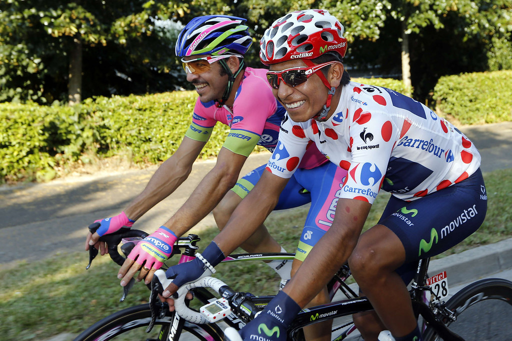 . Second-placed in the overall standings and best climber\'s polka dot jersey Colombia\'s Nairo Quintana (R) rides next to Colombia\'s Jose Serpa during the 133.5 km twenty-first and last stage of the 100th edition of the Tour de France cycling race on July 21, 2013 between Versailles and Paris.  PASCAL GUYOT/AFP/Getty Images