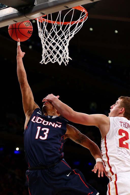 . Shabazz Napier #13 of the Connecticut Huskies goes to the hoop against Matt Thomas #21 of the Iowa State Cyclones during the regional semifinal of the 2014 NCAA Men\'s Basketball Tournament at Madison Square Garden on March 28, 2014 in New York City.  (Photo by Elsa/Getty Images)