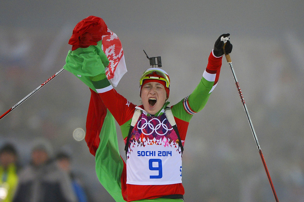 . Belarus\' Darya Domracheva celebrates winning gold in the Women\'s Biathlon 10 km Pursuit at the Laura Cross-Country Ski and Biathlon Center during the Sochi Winter Olympics on February 11, 2014 in Rosa Khutor near Sochi .   PIERRE-PHILIPPE MARCOU/AFP/Getty Images