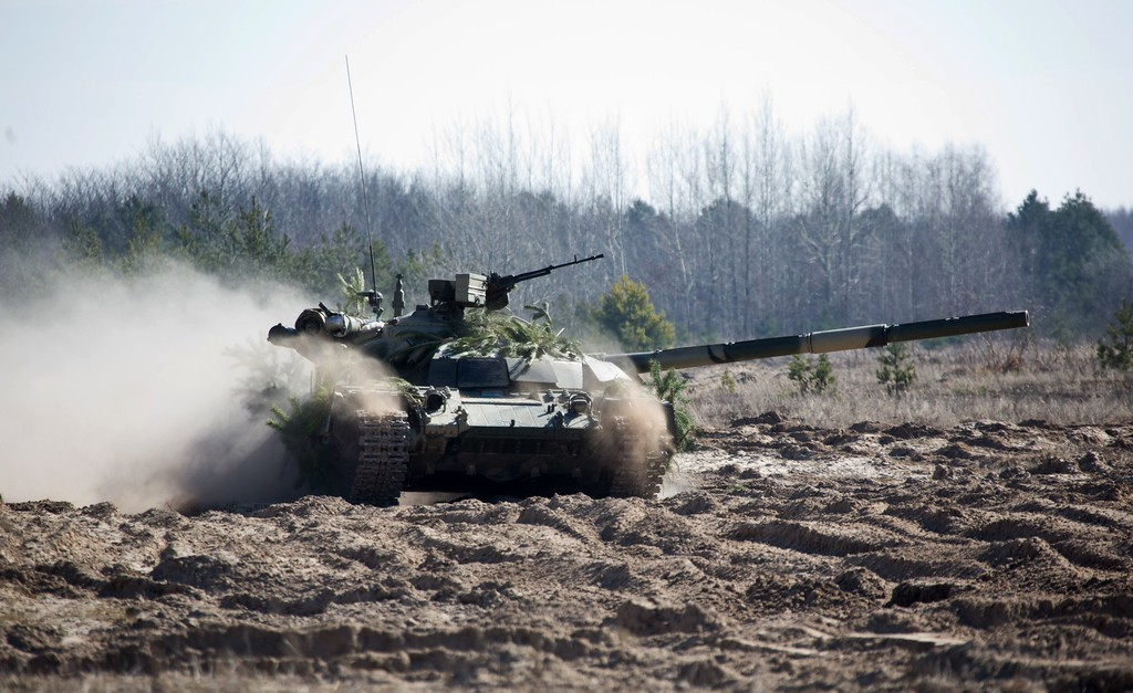 . In this photo taken Friday, March 14, 2014, a Ukrainian APC moves during military exercises of Ukrainian troops near Chernigiv, 150 km (94 miles) north of Kiev, Ukraine. (AP Photo/Mykhailo Markiv, Pool)