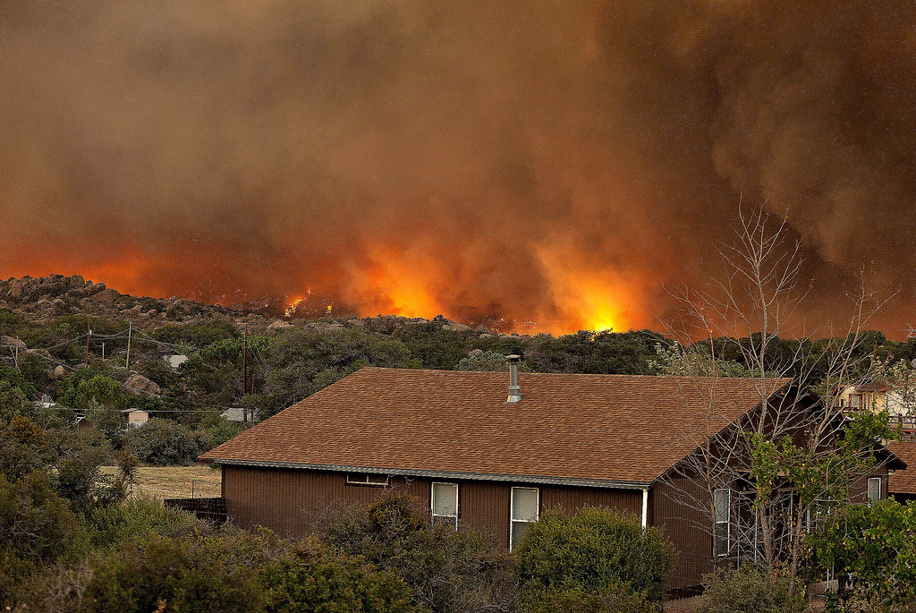 . The Yarnell Hill Fire burns through the town of Yarnell, Ariz. on Sunday, June 30, 2013. The fire started Friday and picked up momentum as the area experienced high temperatures, low humidity and windy conditions. It has forced the evacuation of residents in the Peeples Valley area and in the town of Yarnell. (AP Photo/The Arizona Republic, Tom Story)