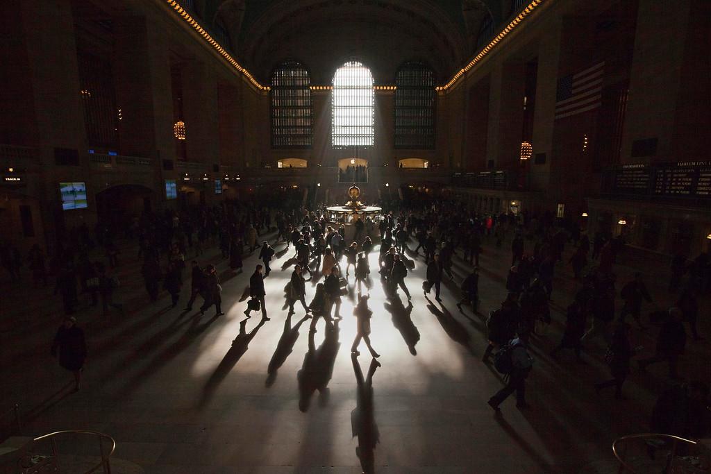 . Morning commuters are silhouetted as they walk through the main concourse of the Grand Central Terminal, also known as Grand Central Station, in New York March 5, 2012.  REUTERS/Adrees Latif