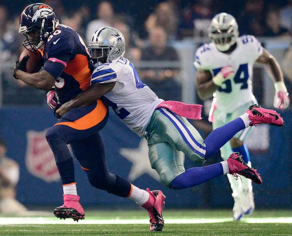 . Barry Church (42) of the Dallas Cowboys tackles Julius Thomas (80) of the Denver Broncos during the second half of the Broncos\' 51-48 win at AT&T Stadium.  (Photo by AAron Ontiveroz/The Denver Post)