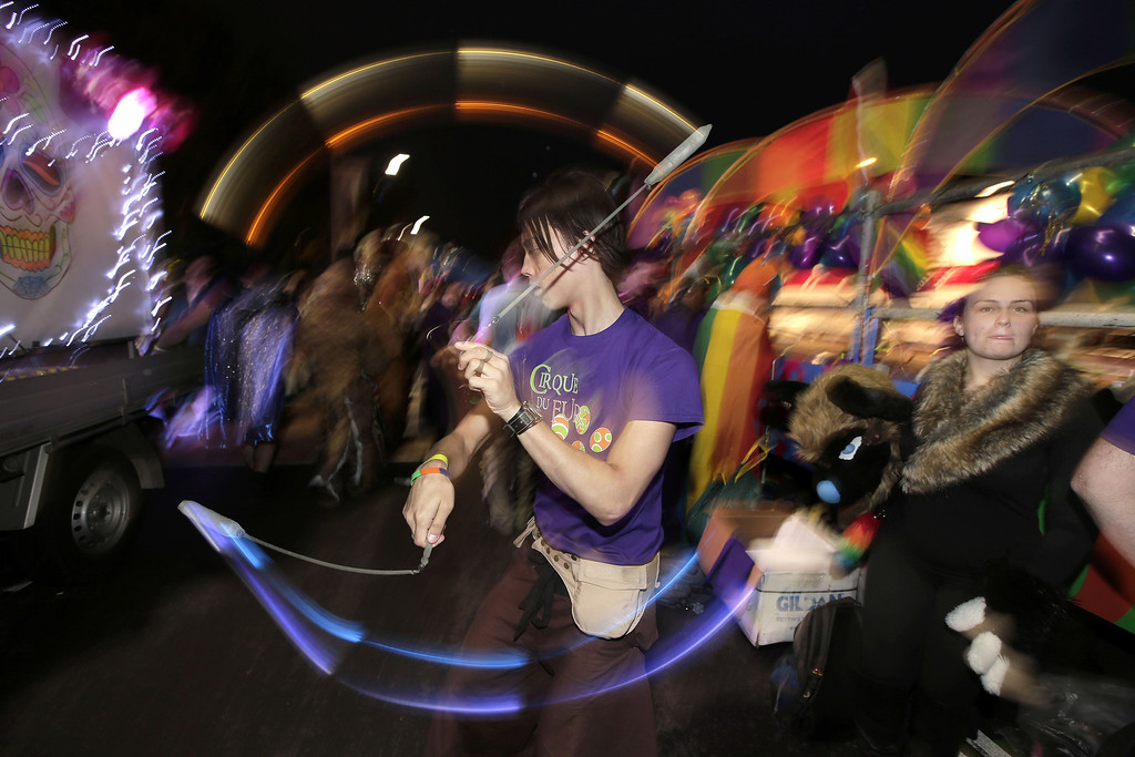 . A parade participant swings light sticks as he celebrates Mardi Gras in Sydney, Australia, Saturday, March 2, 2013. 10,000 are marching along side 115 floats in the annual parade that celebrates lesbian and gay pride. (AP Photo/Rick Rycroft)