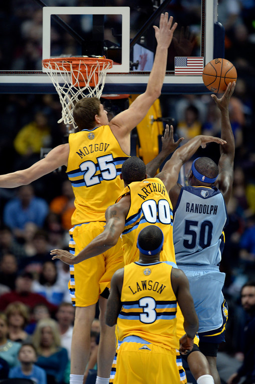 . DENVER, CO. - JANUARY 03:  Nuggets\' center Timofey Mozgov (25) came across to swat away an attempt by Grizzlies\' forward Zach Randolph (50) in the first half. The Denver Nuggets hosted the Memphis Grizzlies at the Pepsi Center Friday night, January 3, 2014. Photo By Karl Gehring/The Denver Post