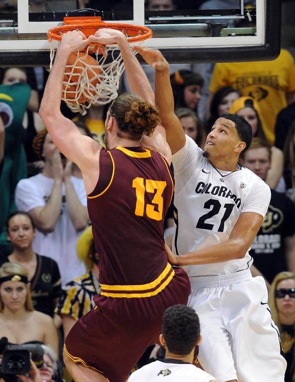 . Jordan Bachynski of Arizona State dunks past Andre Roberson of Colorado during the second half of the February 16th, 2013 game in Boulder. Cliff Grassmick / February 16, 2013