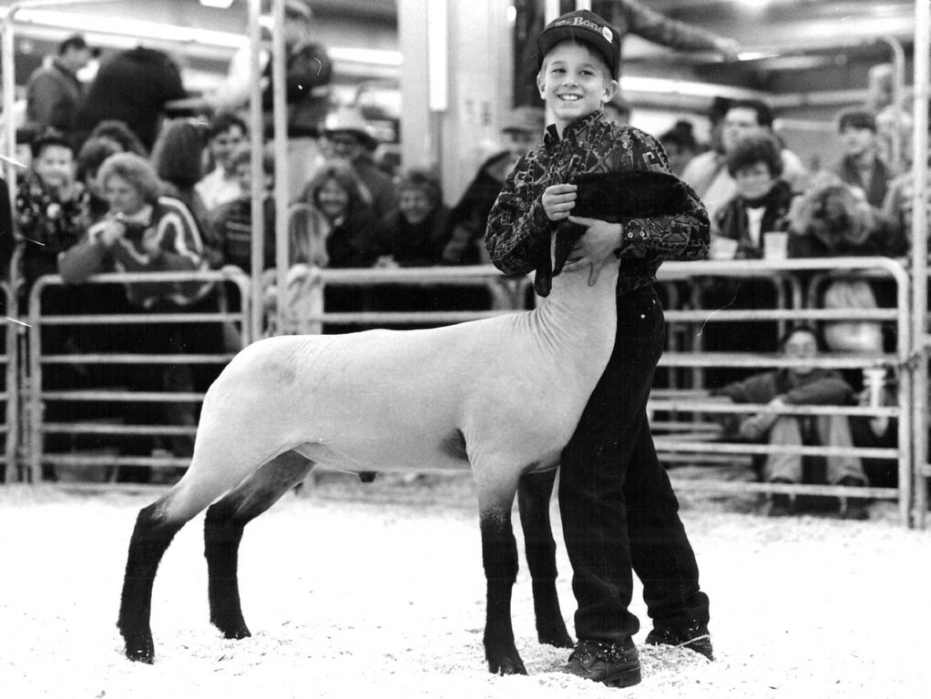 . 10 year old Joaquin Crego of fort Collins with his Grands Champion Junior Market Lamb. 1983. Denver Post Library photo archive