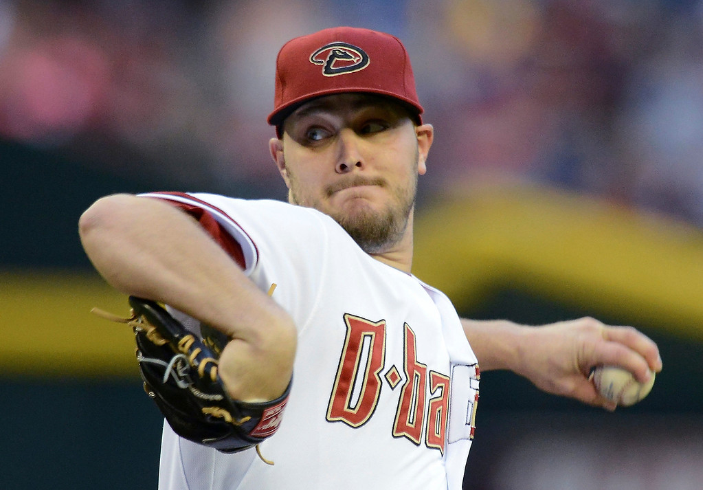 . Wade Miley #36 of the Arizona Diamondbacks delivers a first-inning pitch against the Colorado Rockies at Chase Field on April 28, 2014 in Phoenix, Arizona.  (Photo by Norm Hall/Getty Images)