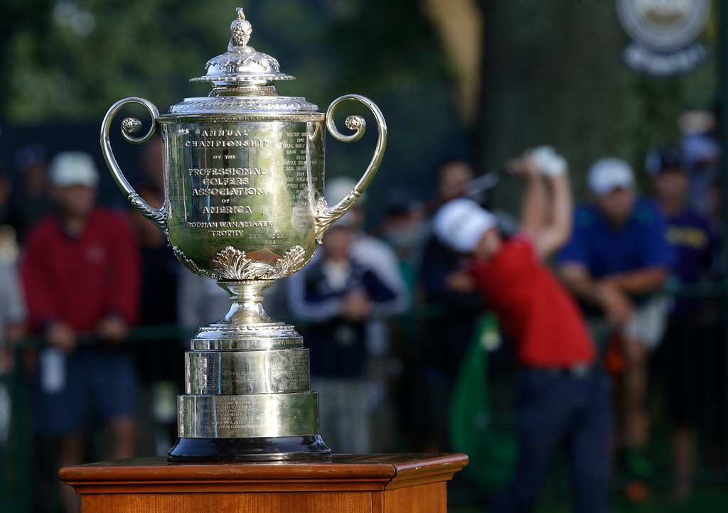 . The Wanamaker Trophy is displayed near the first hole as Luke Guthrie tees off during the first round of the PGA Championship golf tournament at Oak Hill Country Club, Thursday, Aug. 8, 2013, in Pittsford, N.Y. (AP Photo/Patrick Semansky)