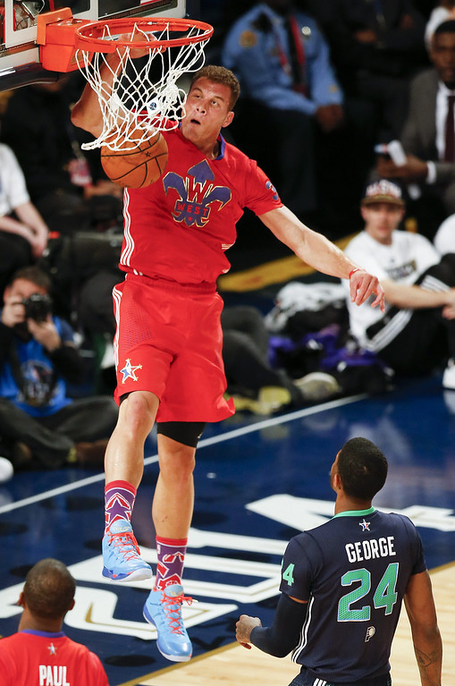 . Western Conference forward Blake Griffin (L) dunks over Eastern Conference forward Paul George (R) during the first half of the 63rd NBA All-Star Game in New Orleans, Louisiana.  EPA/DAN ANDERSON