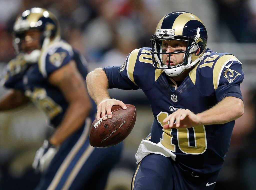 . St. Louis Rams quarterback Kellen Clemens (10) scrambles against a Seattle Seahawks defense during the first half of an NFL football game, Monday, Oct. 28, 2013, in St. Louis. (AP Photo/Michael Conroy)