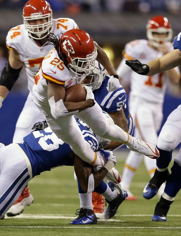 . Indianapolis Colts cornerback Greg Toler (28) tackles Kansas City Chiefs running back Jamaal Charles (25) during the first half of an NFL wild-card playoff football game Saturday, Jan. 4, 2014, in Indianapolis. (AP Photo/Michael Conroy)