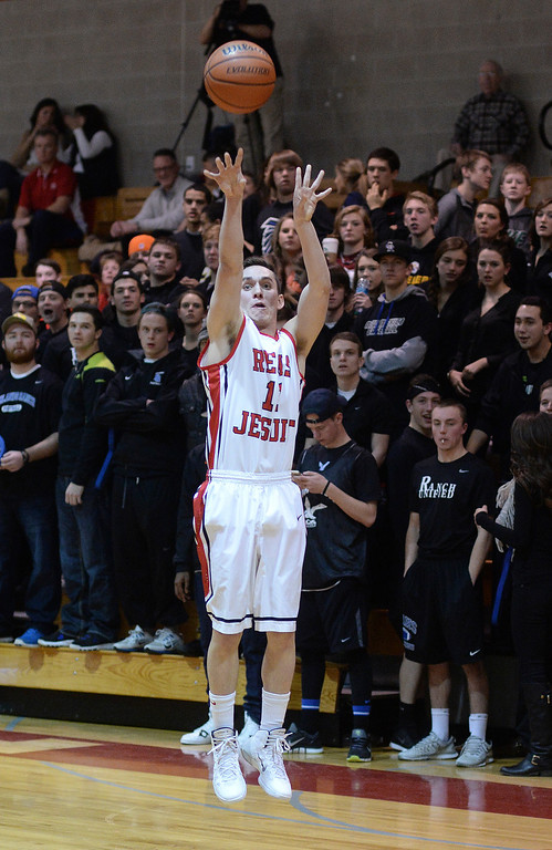 . Regis senior guard Zach Smith quieted the Falcons\' student section with a long-range jumper in the first quarter. The Regis Jesuit High School boy\'s basketball team defeated Highlands Ranch 63-54 Tuesday night, February 4, 2014. Photo By Karl Gehring/The Denver Post