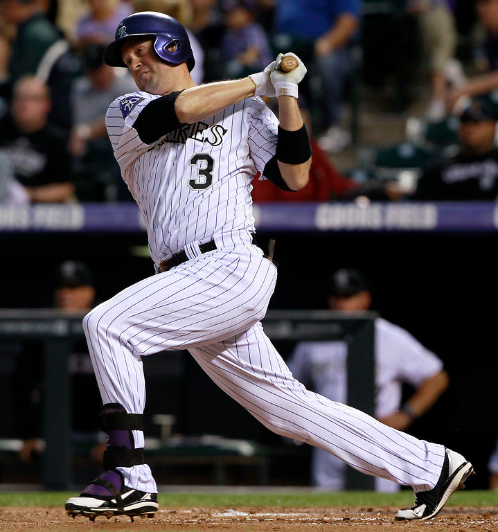 . Colorado Rockies\' Michael Cuddyer singles against the St. Louis Cardinals in the first inning of a baseball game in Denver on Wednesday, Sept. 18, 2013. (AP Photo/David Zalubowski)