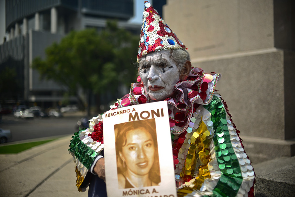 . A clown takes part in a march with a group of mothers and relatives of children missing due to the drug war in the country, to demand to the Government the investigation of the crimes, in Mexico City on May 10, 2013. Ronaldo Schemidt/AFP/Getty Images