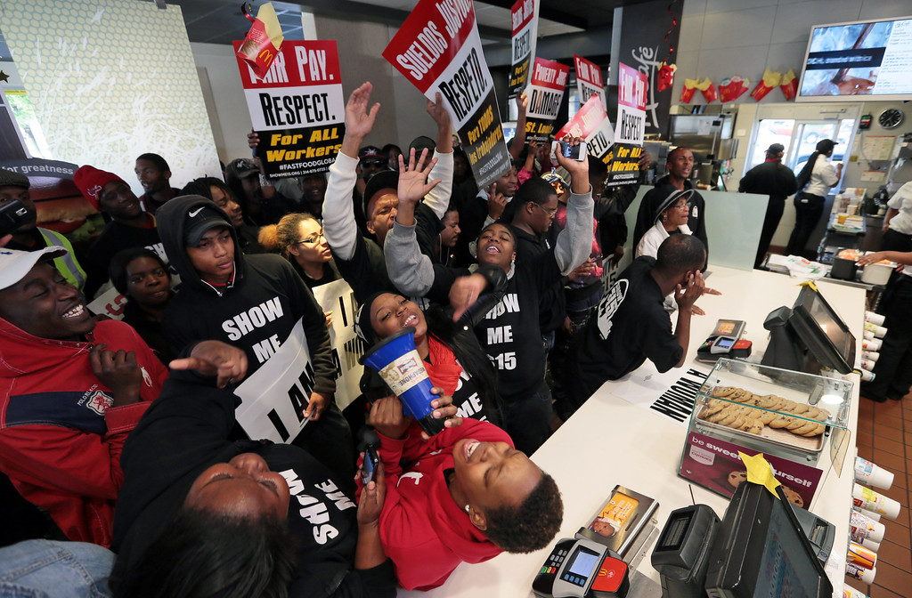 . Shermale Humphrey shouts slogans into a megaphone, as she leads a group of fast-food workers protesting for better wages on Thursday, May 15, 2014, inside a McDonald\'s in St. Louis. (AP Photo/St. Louis Post-Dispatch, Laurie Skrivan)