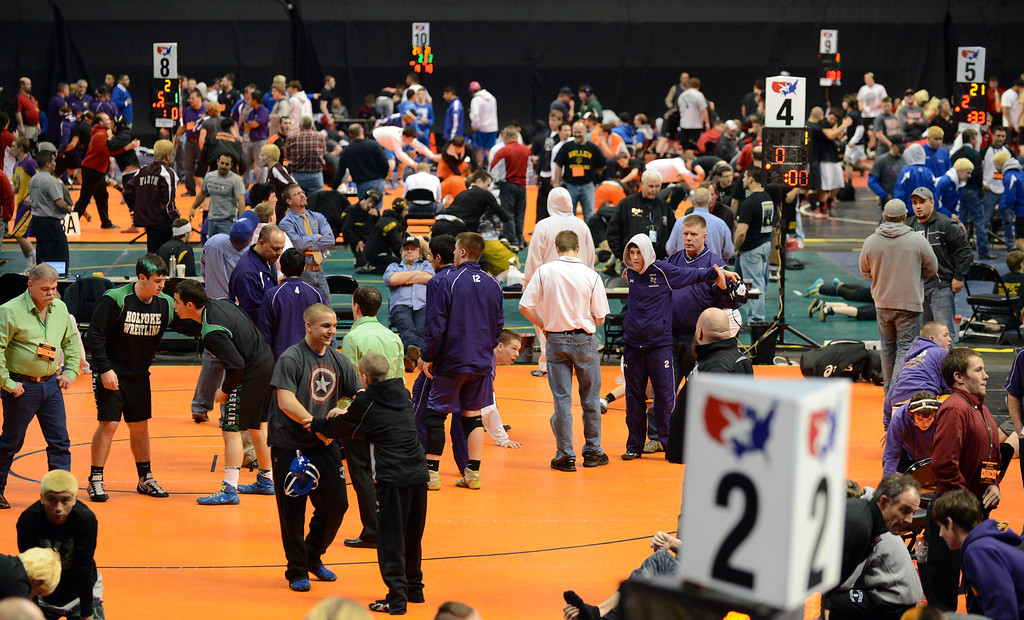 . DENVER, CO. - FEBRUARY 22: The wrestlers are warming up for their matches for the High School State Championship tournament at Pepsi Center February 22, 2013. Denver, Colorado. (Photo By Hyoung Chang/The Denver Post)